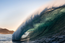 Wave Breaking On A Sunset Beac...