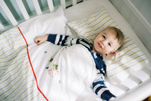 Little Toddler Boy In His Crib Not Wanting To Nap.