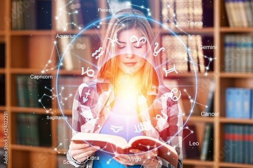 Fotografia Horoscope astrology zodiac illustration with old book in hands