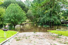 Post Hurricane Flooding Leaves A Neighborhood Devastated. Storm Damage From Floods Is A Side Effect Of Climate Change.