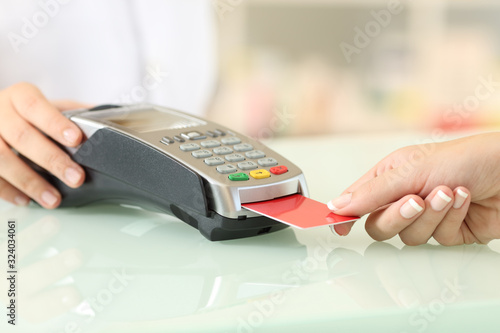 Fotografía Client paying with credit card reader in a pharmacy