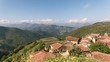 """small town in the Cantabrian mountain called """"Cabezon de Liebana"""", surrounded by green pastures"""