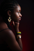 Colorful And Dark Side View Portrait Of Native African Woman