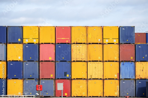 Fototapeta Colorful freight containers stacked up on the quay for shipping in the cargo port obraz
