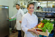 Female Chef Showing Crate Of Fresh Fruit And Vegetables