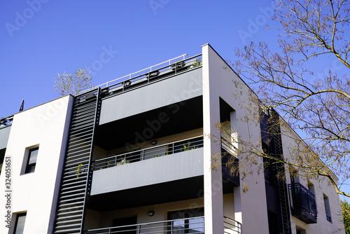 Fototapeta Modern new apartment house residential building outdoor concept obraz