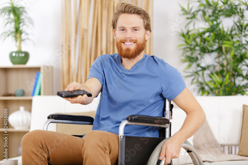 Fototapeta happy handicap man watching television in living room obraz