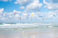 Kiters And Surfers In The Sea In Tel Aviv