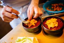 High Angle Close Up Of Chef Preparing Uni, Sea Urchin, With Salmon Roe And Rice.,Otaru