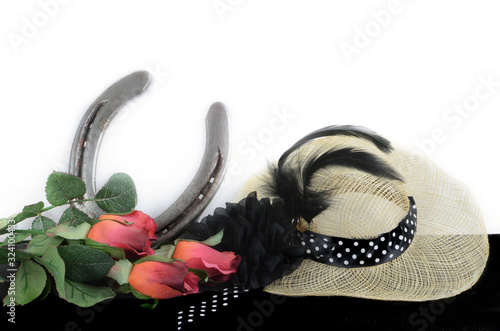 Slika na platnu Kentucky Derby photo of a fascinator hot with red roses and a horseshoe