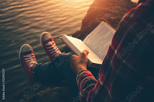 Fototapeta Women read book in the holiday in quiet nature, Concept reading a book. obraz