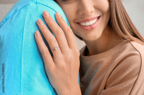Fotografie, Obraz Happy engaged young couple at home, closeup