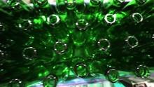 Tilt Shot Of Green Bottles Mov...