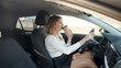 4k video of beautiful sexy woman drinking coffee from paper cup while driving a ccar and commuting to work at morning