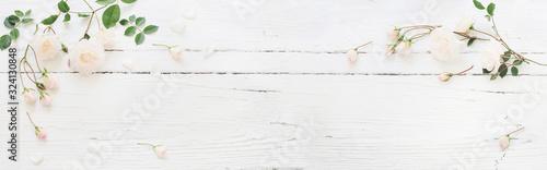 Fototapeta roses on white wooden background obraz