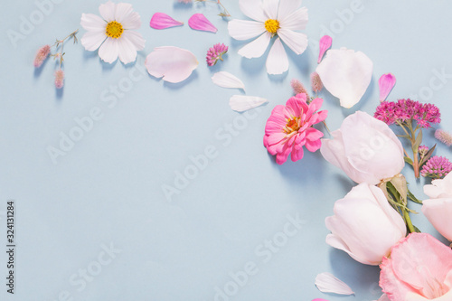 summer flowers on blue paper background - 324131284