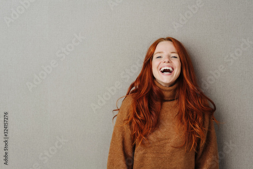 Fototapeta Laughing young woman with vivacious smile