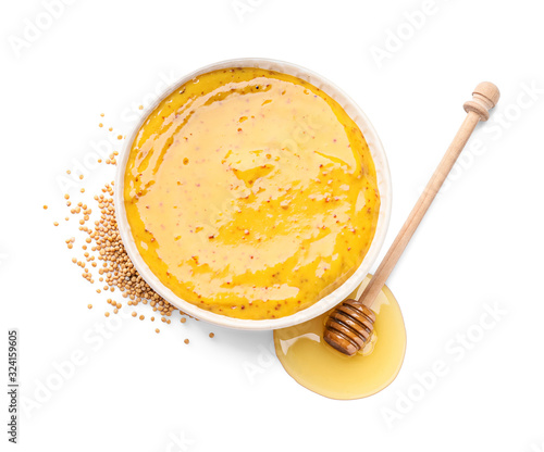 Photo Bowl of tasty honey mustard sauce on white background