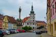 Loket, Czech Republic; 5/19/2019: Loket Market (or main square of Loket), with the Holy Trinity Column on the left and the Town Hall at the background