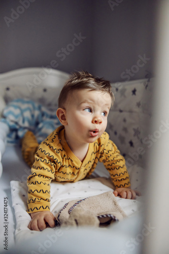 Cute little blond baby boy waking up Canvas Print