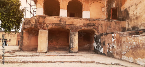Fototapeta Islamabad,Pakistan,January 29,2020:The uninhabited and abandoned palace nearly devastated,old and primitive building with broken doors and burnt walls