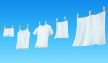 White Clean Linen And Clothes Hanging On A Rope