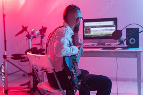 Create music and a recording studio concept - Bearded man guitarist recording el Canvas Print