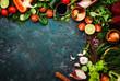 Leinwandbild Motiv Fresh healthy food cooking or salad making ingredients on dark background with rustic wooden board. Diet or vegetarian food concept. Top view, copy space