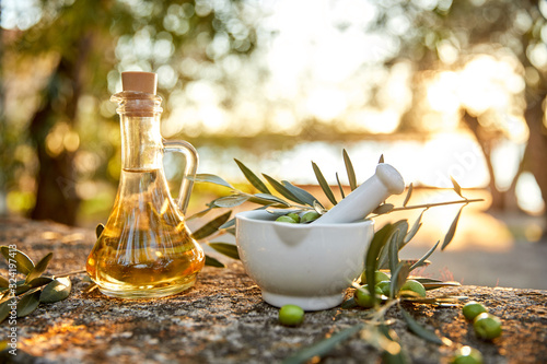 Fototapeta Olive oil and olive berries with leaves outdoor obraz