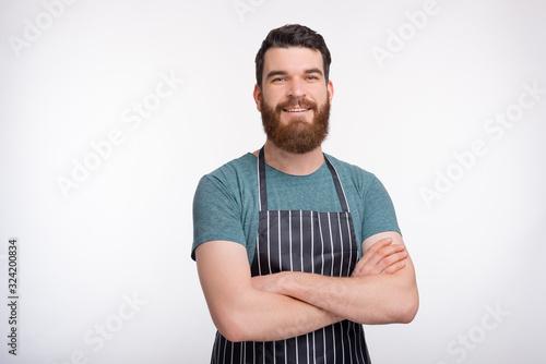 Fototapeta Cooking courses figure. Portrait of a confident bearded cooker o obraz