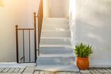 Fototapeta Fototapety na drzwi - Mediterranean white street with vase and plant.
