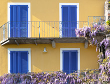 Bright Yellow Facade Of A Blue...