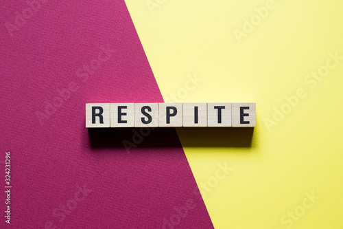 Respite Word Written In Wooden Cube Canvas Print