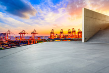 Empty Square Floor And Industrial Container Terminal At Beautiful Sunset In Shanghai.