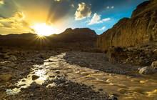 After Rain Water Streams Through The Judean Desert Towards The Dead Sea