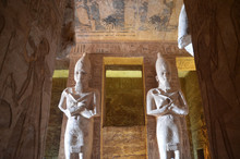 Great Temple Interior, Abu Simbel, Egypt. Statues At The Entrance To The Temple Of King Ramses II In Abu Simbel In Egypt.