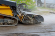 canvas print picture - Removing old asphalt from a street surface road milling machine