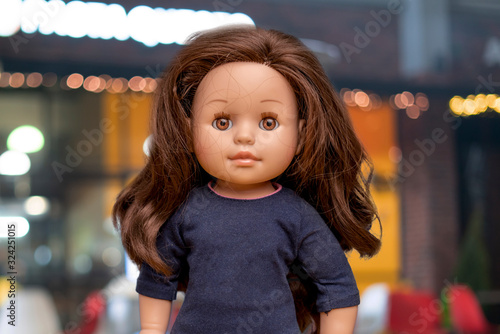 Valokuva beautiful female doll face portrait close up with copy space, girl childhood toy
