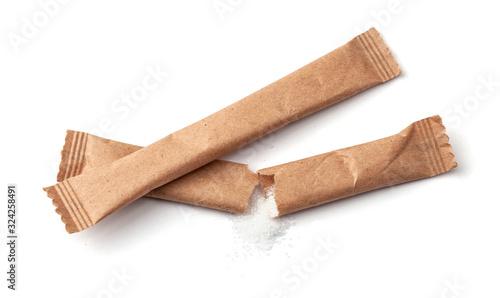 Sugar stick torn in half Fototapet