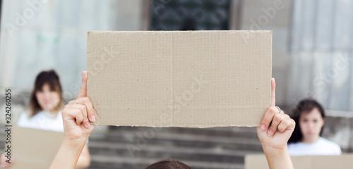 Fototapeta Close-up women holding cardboard signs at protest obraz