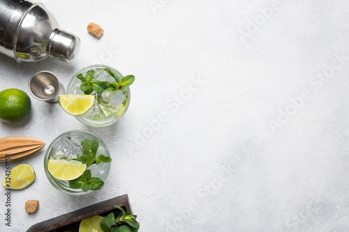 Mojito Cocktail Ingredients and tools on light table Obraz na płótnie