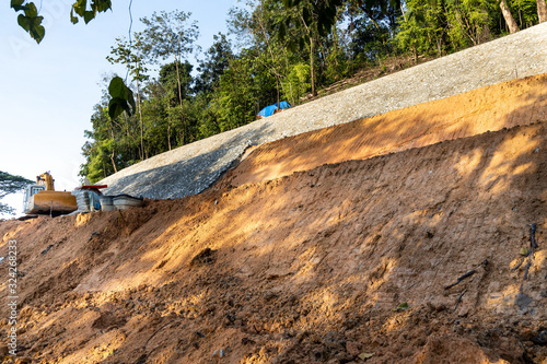 Slope retention construction work being carried out to manage landslide Canvas Print