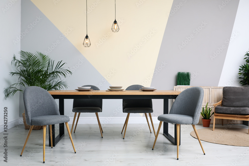 Fototapeta Modern wooden dining table in room interior