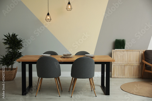 Fotomural Modern wooden dining table in room interior