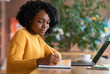 Motivated afro woman looking for new job online