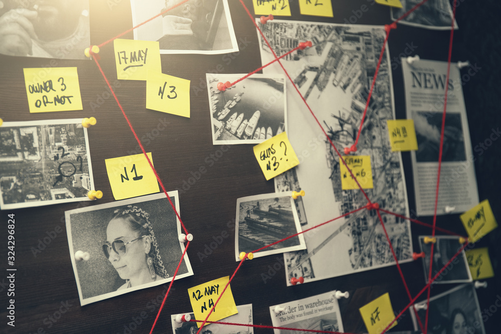 Fototapeta Detective board with crime scenes, photos of suspects and victims, evidence with red threads, vintage toned