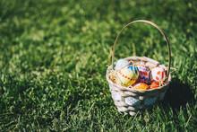 Painted Easter Eggs In Wicker Basket.