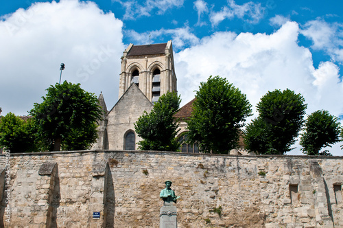 Church of  Auvers-sur-Oise and Daubigny statue, France Canvas Print