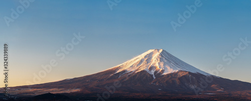 Japanese Fuji mountain on blue sky with copy space.