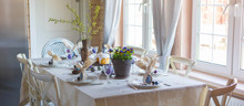 Easter Festive Spring Table Setting Decoration, Bunny Ears Shaped Napkins, Dyed Eggs, Cakes, Flowers, Selective Focus
